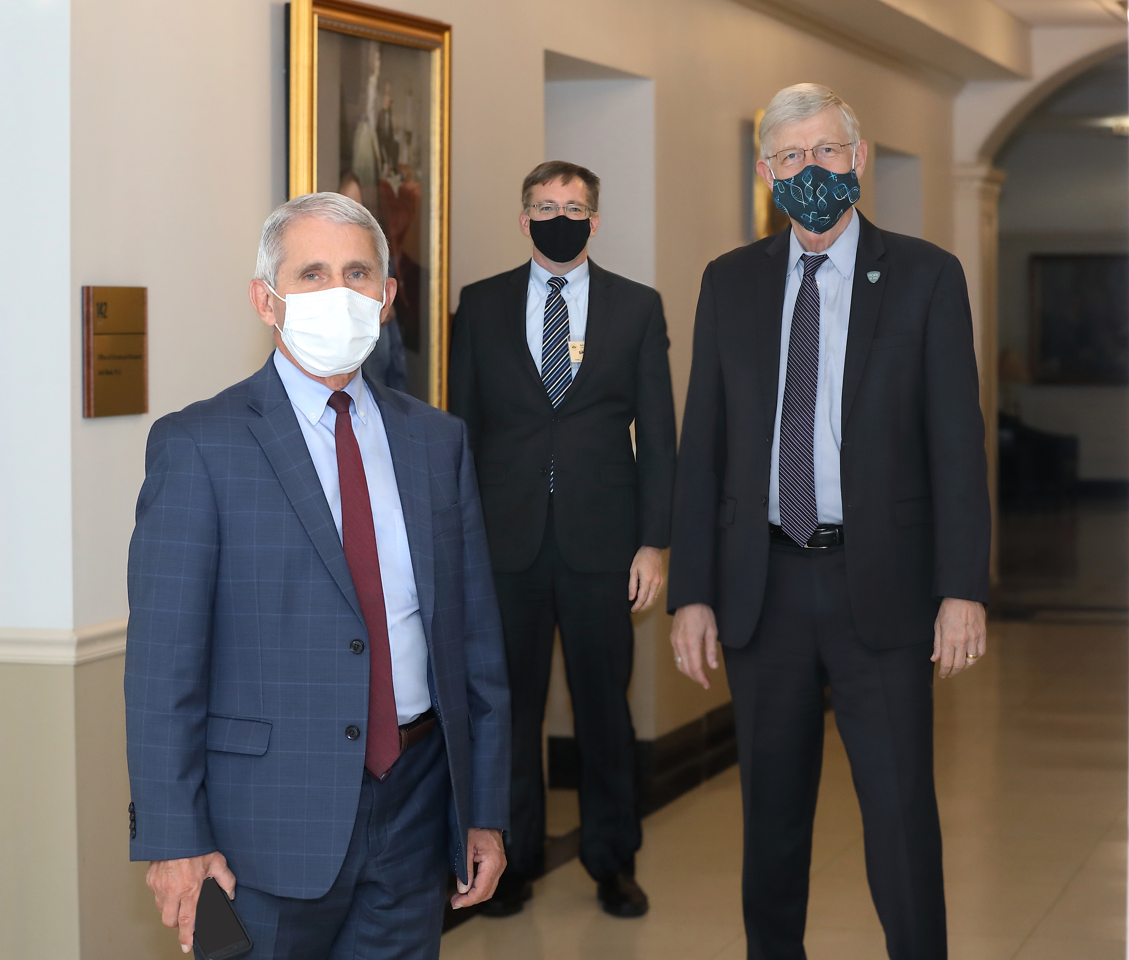 Fauci, Hepburn, and Collins in Hallway