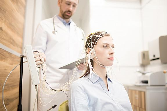 Young woman undergoing electroencephalography