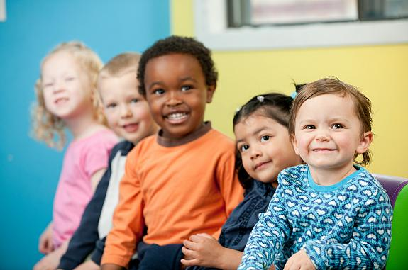A group of preschool children smiling.