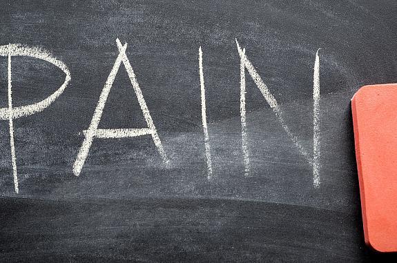 the word 'pain' written on a chalk board