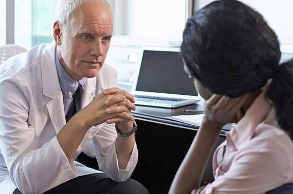 A woman talking with her doctor.