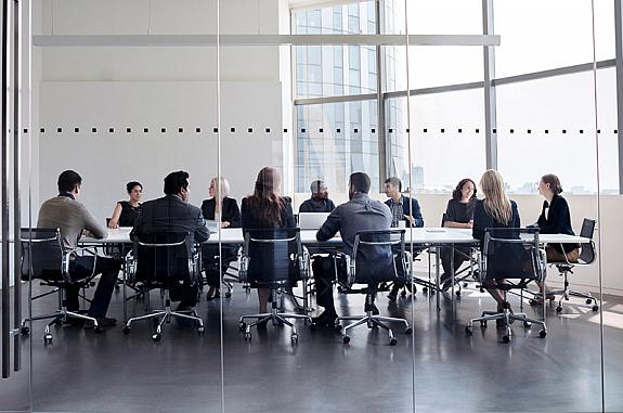 Business people seated at a conference table