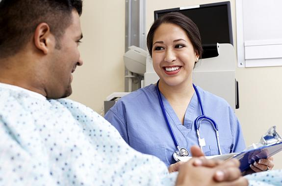 A female doctor speaking with a male patient.
