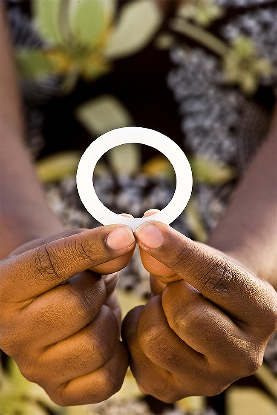 Woman holding the dapivirine vaginal ring tested in the NIH-funded ASPIRE study.