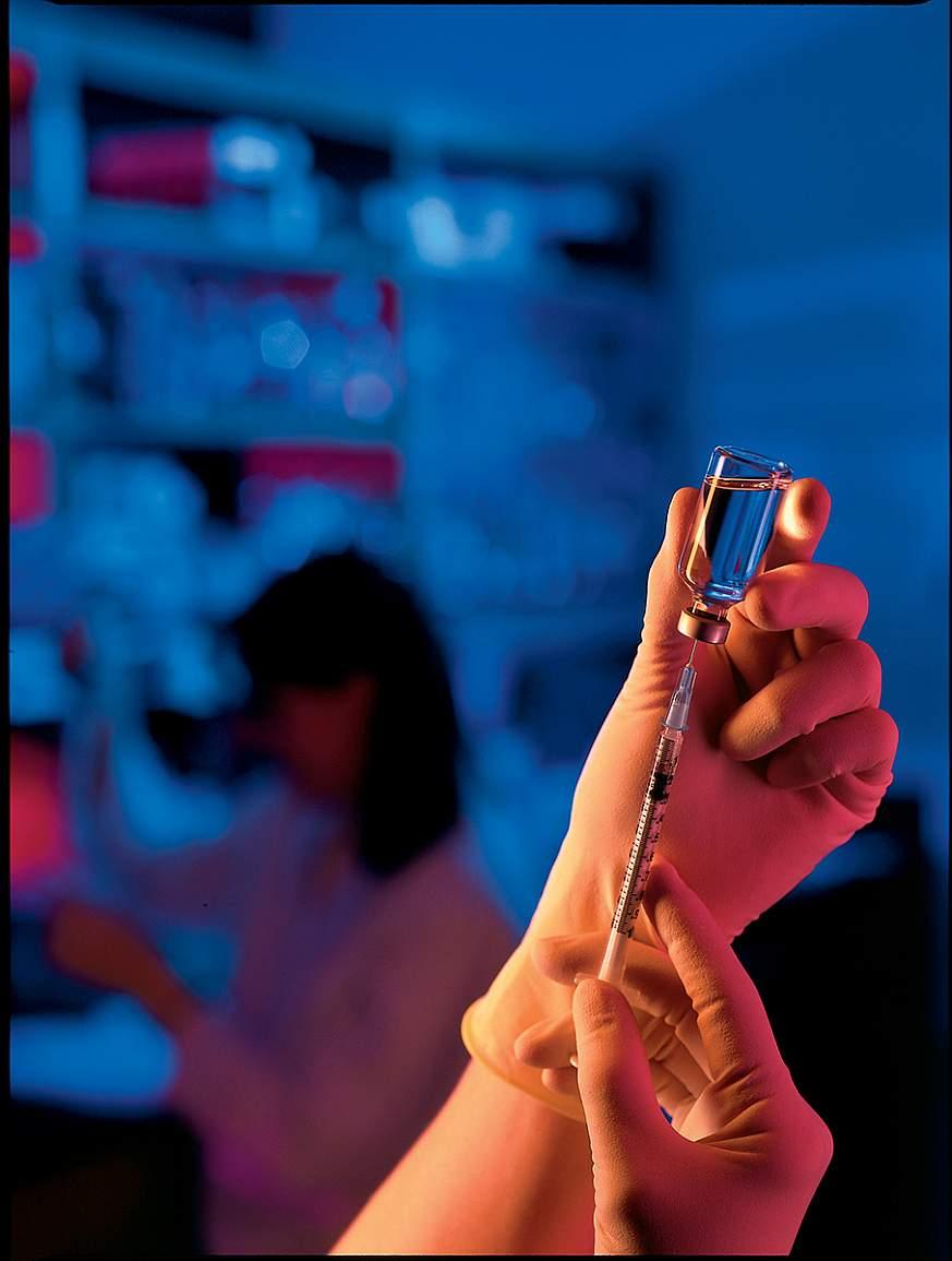 hands holding vaccine vial