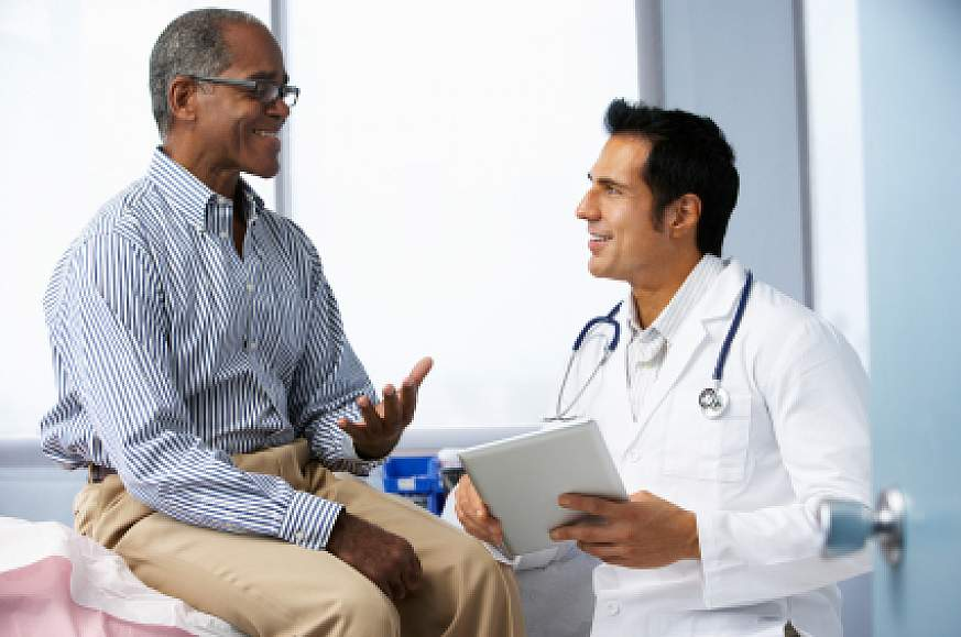 A man talking with his doctor