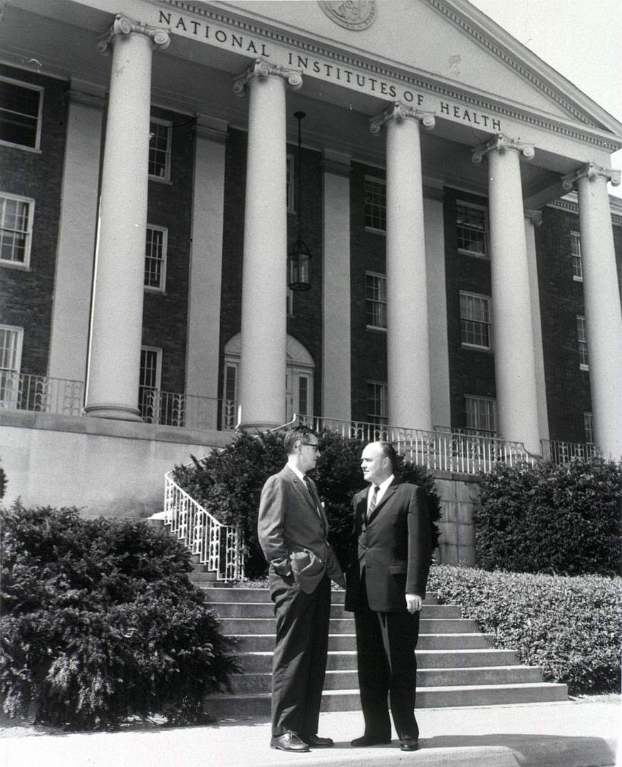 Congressman Melvin Laird (right) with NIH Director James Shannon in front of NIH's main administration building.