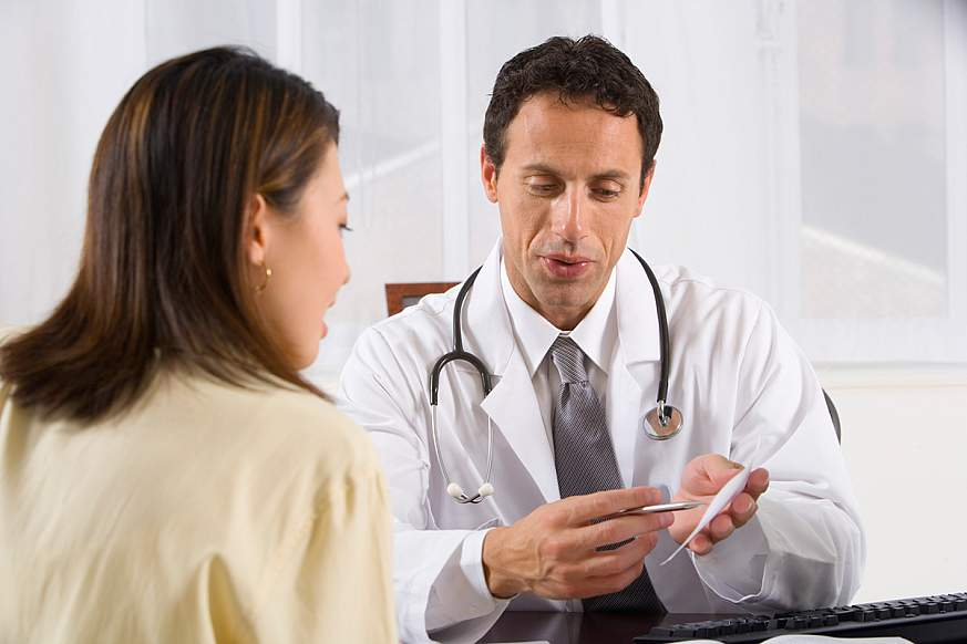 Doctor talking to a patient.