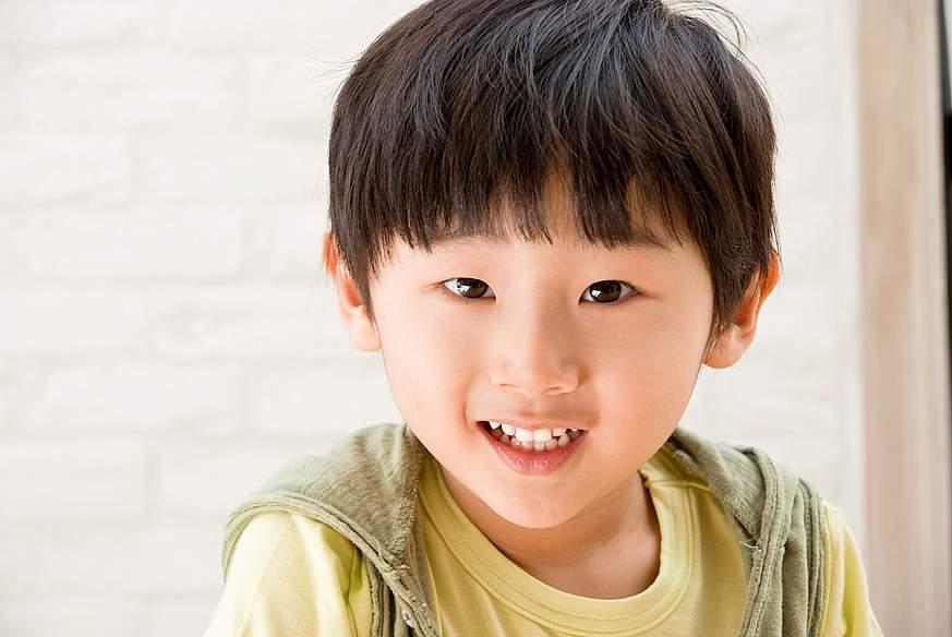 A happy Asian boy.