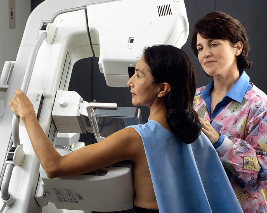 Woman receiving a mammography.