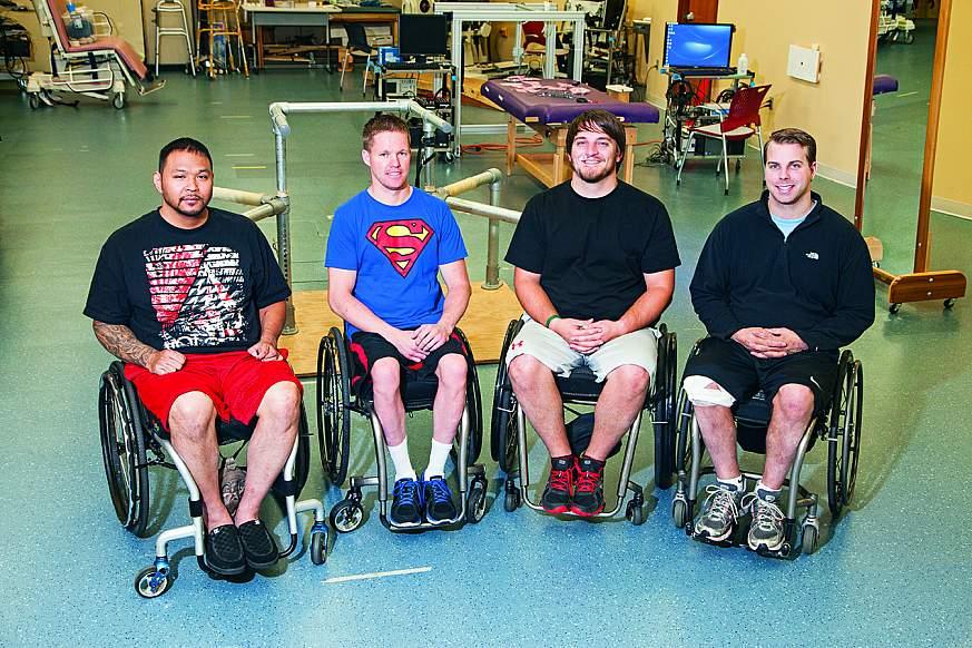 Four men sitting in wheelchairs.