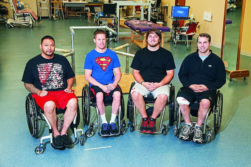 Four men sitting in wheelchairs.