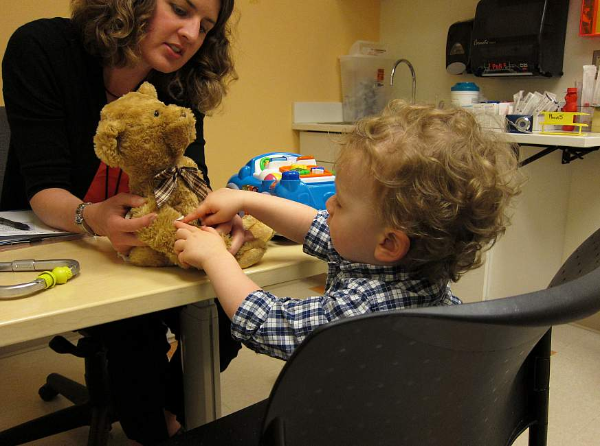 Image of a nurse speaking to a young boy