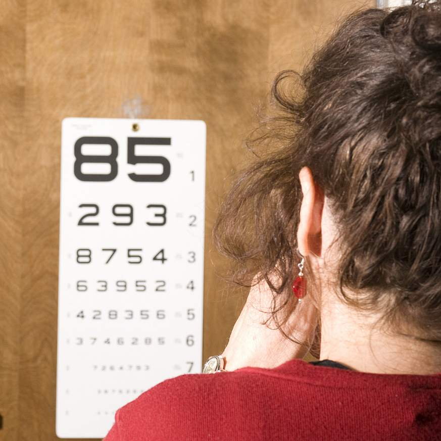 Image of a patient reading an eye chart.