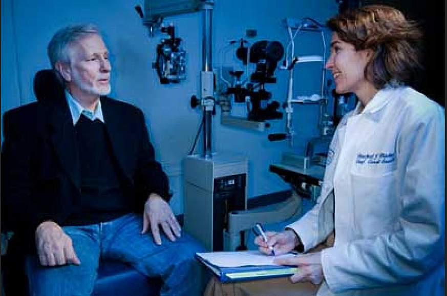 An eye care professional consults with a patient.