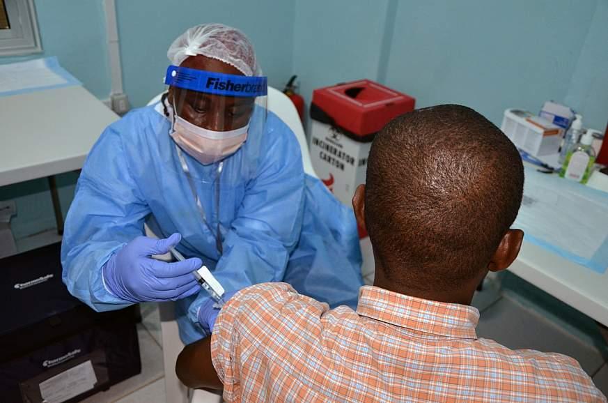 Image of a volunteer receiving a vaccine