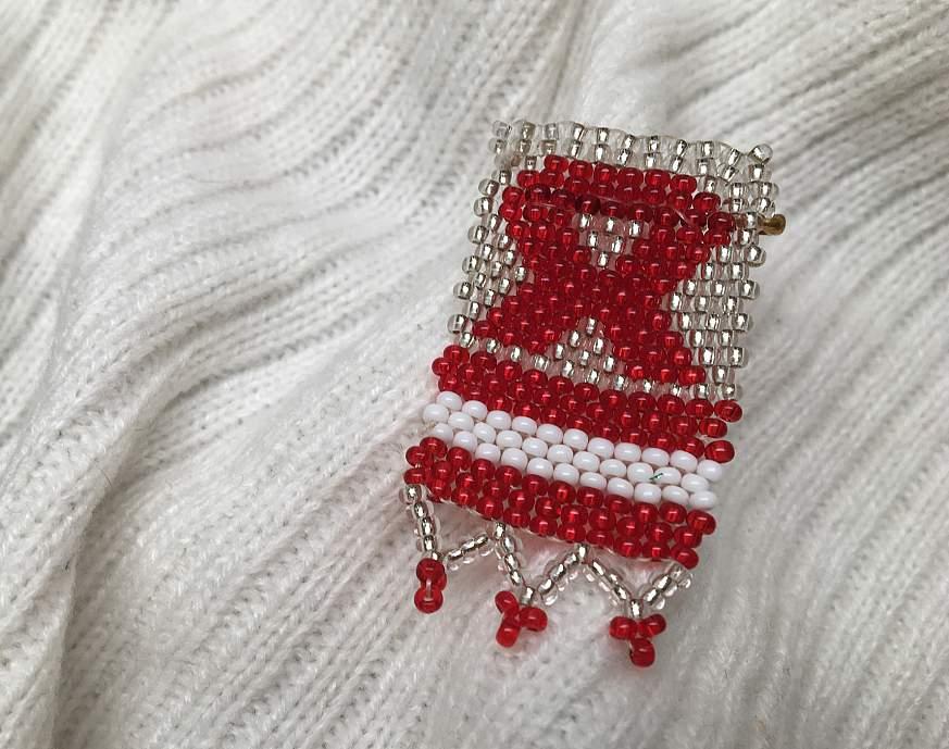 HIV/AIDS Awareness ribbon pin.