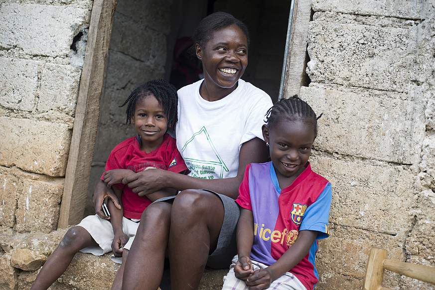 Image of a health worker with children