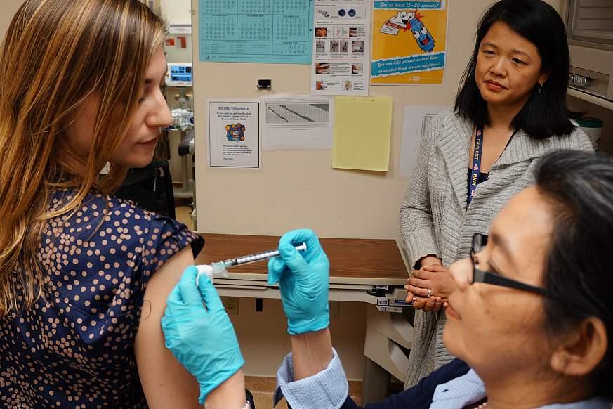 Image of a volunteer receiving a shot