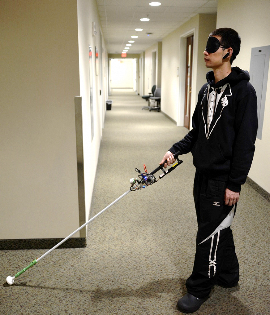 Person tests robotic cane