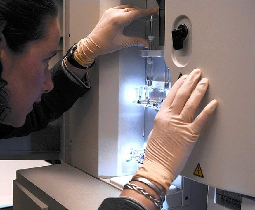 Researcher with a DNA sequencer.