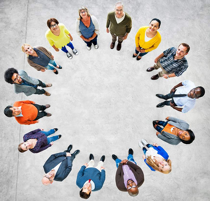 A group of people standing in a circle looking up.