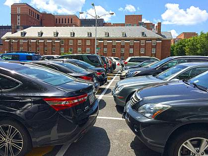 Parking lot filled with cars on the NIH campus.
