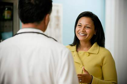 A potential volunteer talks with her doctor about participating in a clinical trial.