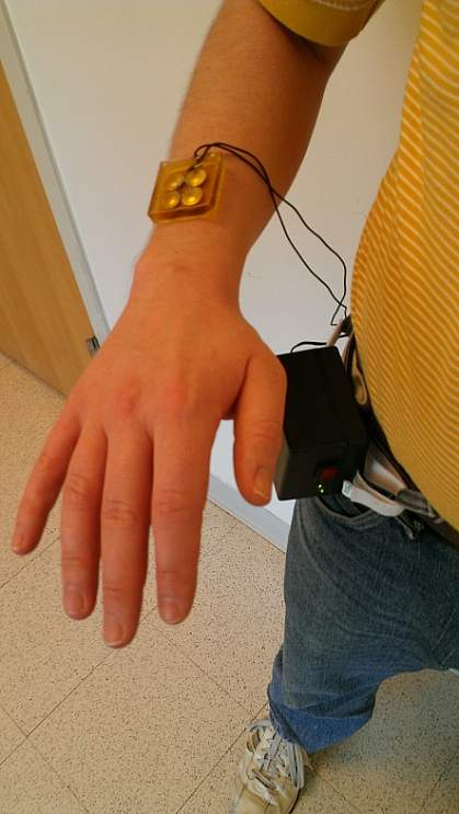 Image of a person wearing the therapeutic ultrasound patch