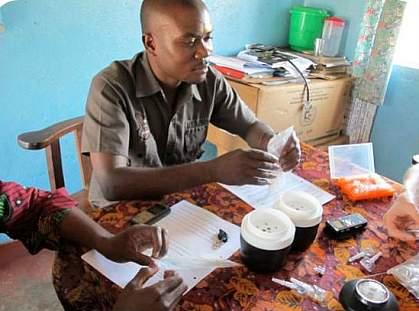 Photo of Zambian health care worker testing NINA prototype