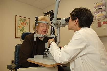 Image of a doctor performing an eye exam.