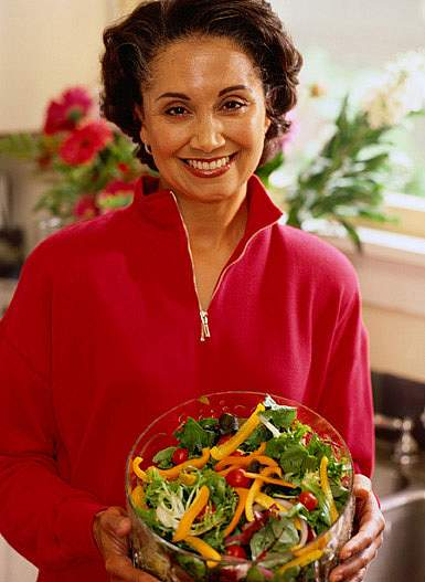 photo of a woman holding a salad