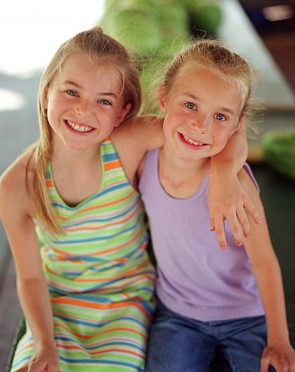 photo of two young girls smiling