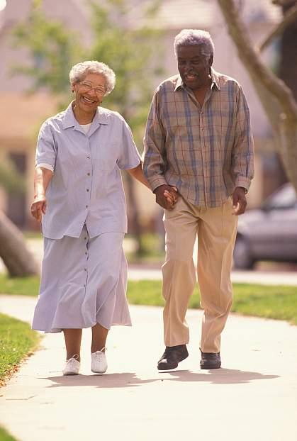 photo of an elderly couple walking