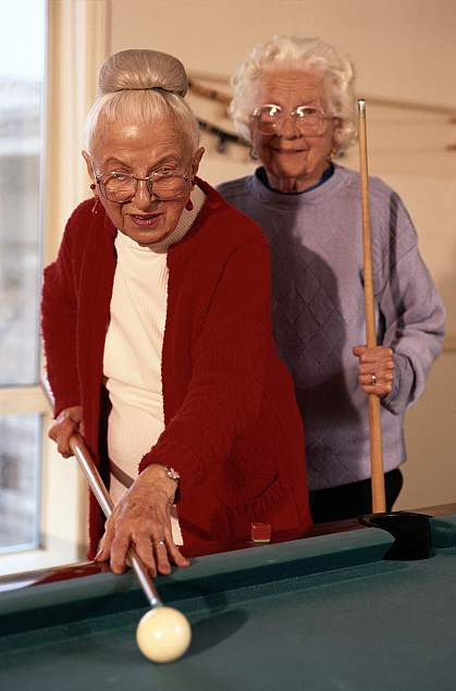 Picture of the 2 older women playing pool