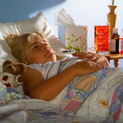 A young girl in bed with the flu