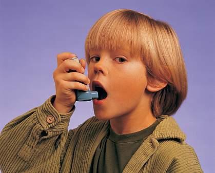 A young boy using an inhaler