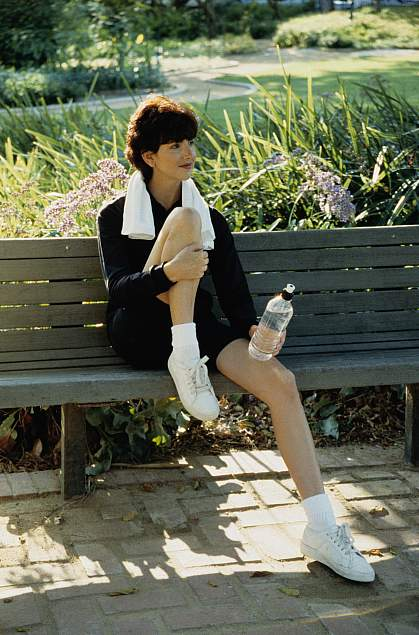 A young woman relaxing on a bench