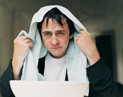 An unhappy man with the flu