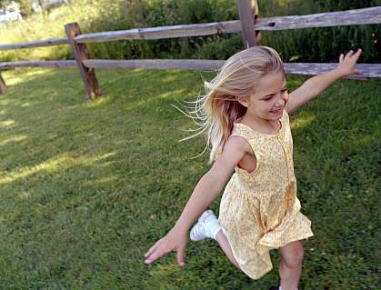 A young girl running in the park