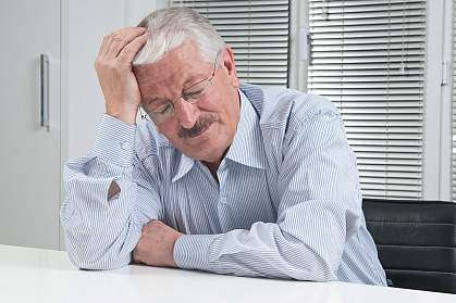 Photo of a man suffering with a migraine headache