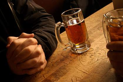 Picture of a mug of beer sitting on a bar