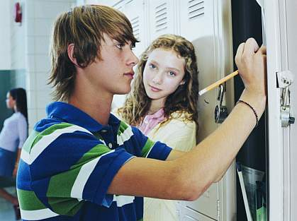 Teenage boy at his school locker