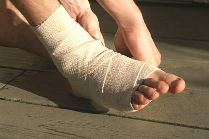 Foot and ankle wrapped with an elastic bandage