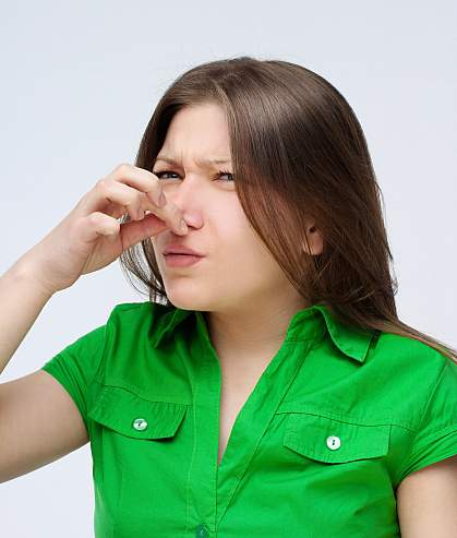 Photo of a woman holding her nose