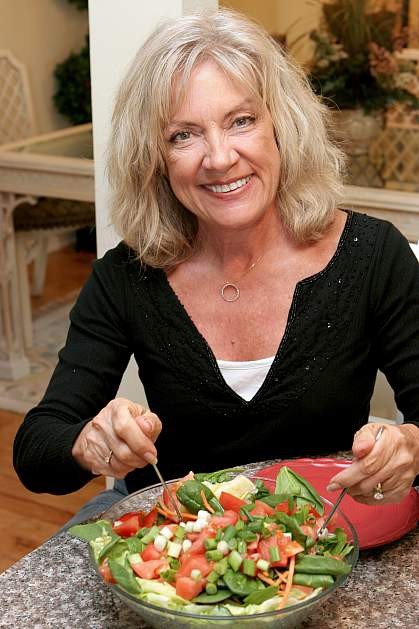 Older woman eating a salad