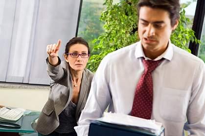 A female boss yelling at a male employee