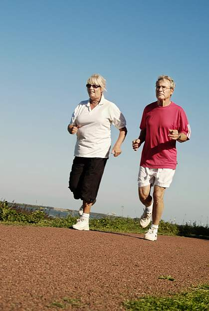 a photo of a man and a woman jogging