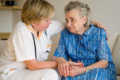 Photo of a nurse caring for an older woman