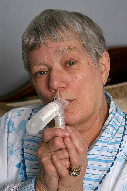 Photo of an older woman using a nebulizer